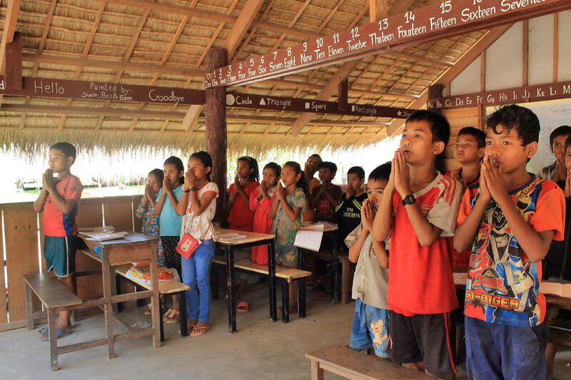 Children reciting daily prayer cambodia school