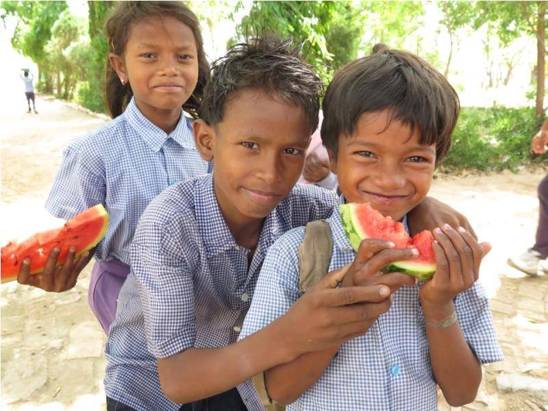 Indian kids eating watermelon on IVI project