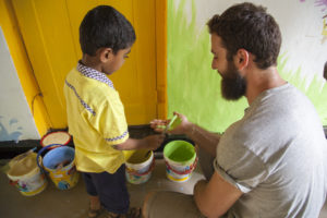 volunteers refurbishing a school in sri lanka