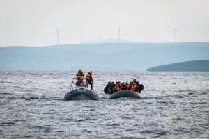 refugee boat arrival volunteering greece