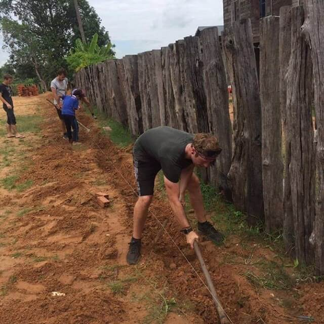 volunteer rebuilding in cambodia rural school