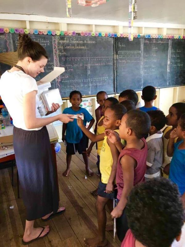 Jess at the school helping the kids