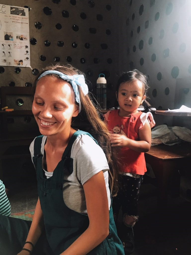 Georgina getting a hair cut 768x1024 - Nepal Kindergarten Volunteering Feedback