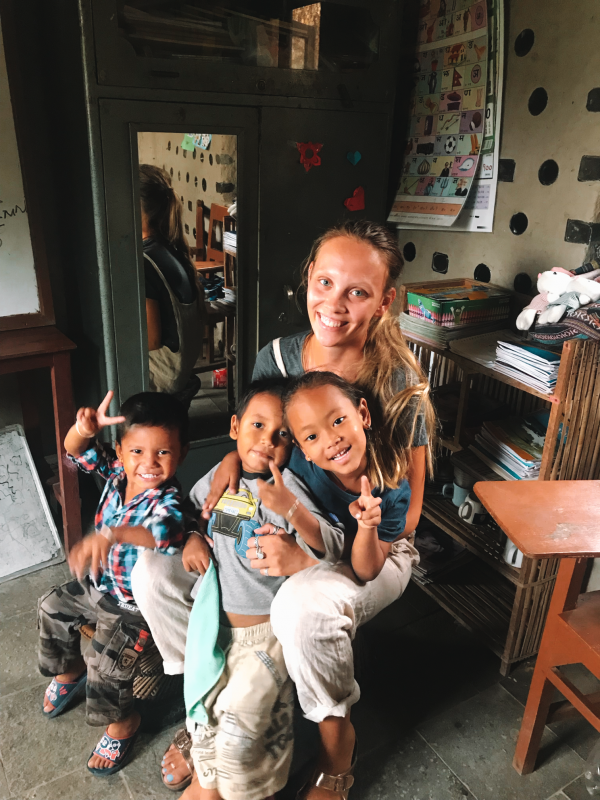 Kindergarten children with Georgina the IVI volunteer