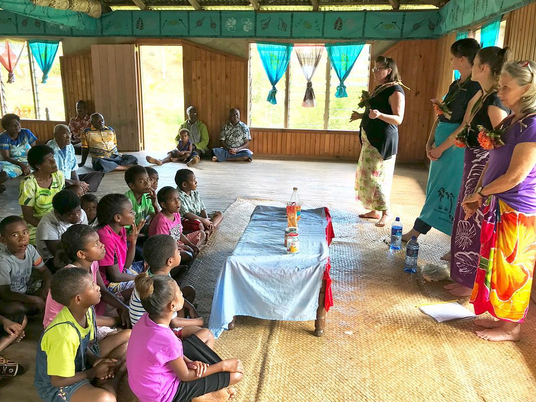 IVI volunteers teaching fijian children about sugar and diet