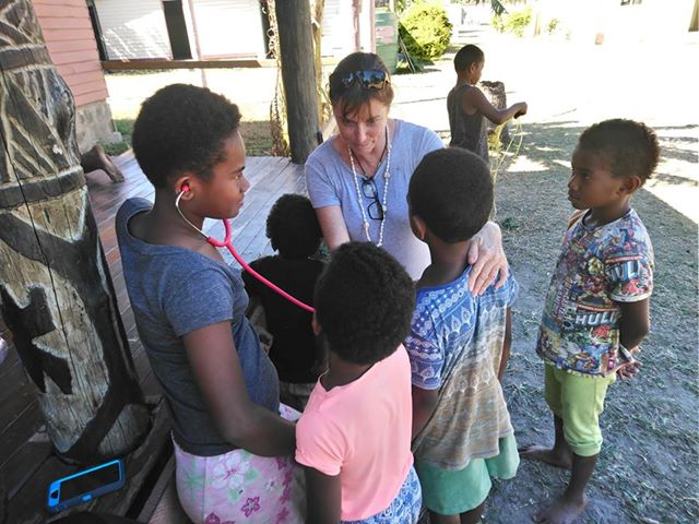 Suanne in fiji with stethiscope - Hospital Internship & Health Program Review