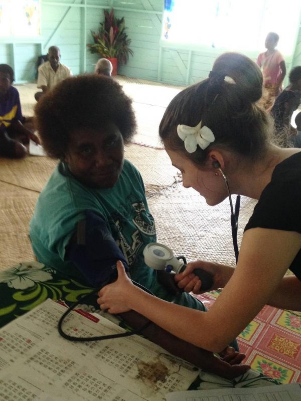 holly underhill naturopath doing health checks in fiji