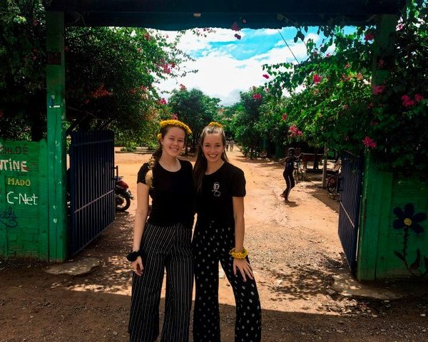 2 volunteers outfront of school cambodia wtih daisies in their hair 600x480 - Cambodia Review