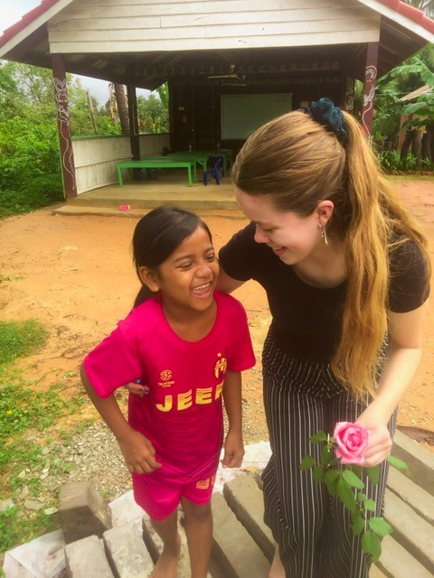 Lovely photo of volunteer grace with a child