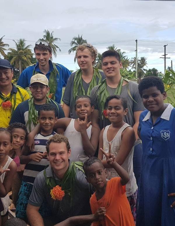 fiji photo with kids and uni volunteers 600x771 - Kindergarten Rebuilding - Woman & Children's Commune Fiji