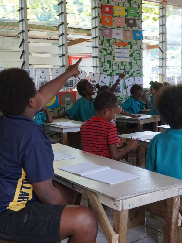 school children with hands up 600x800 - Vanuatu Review