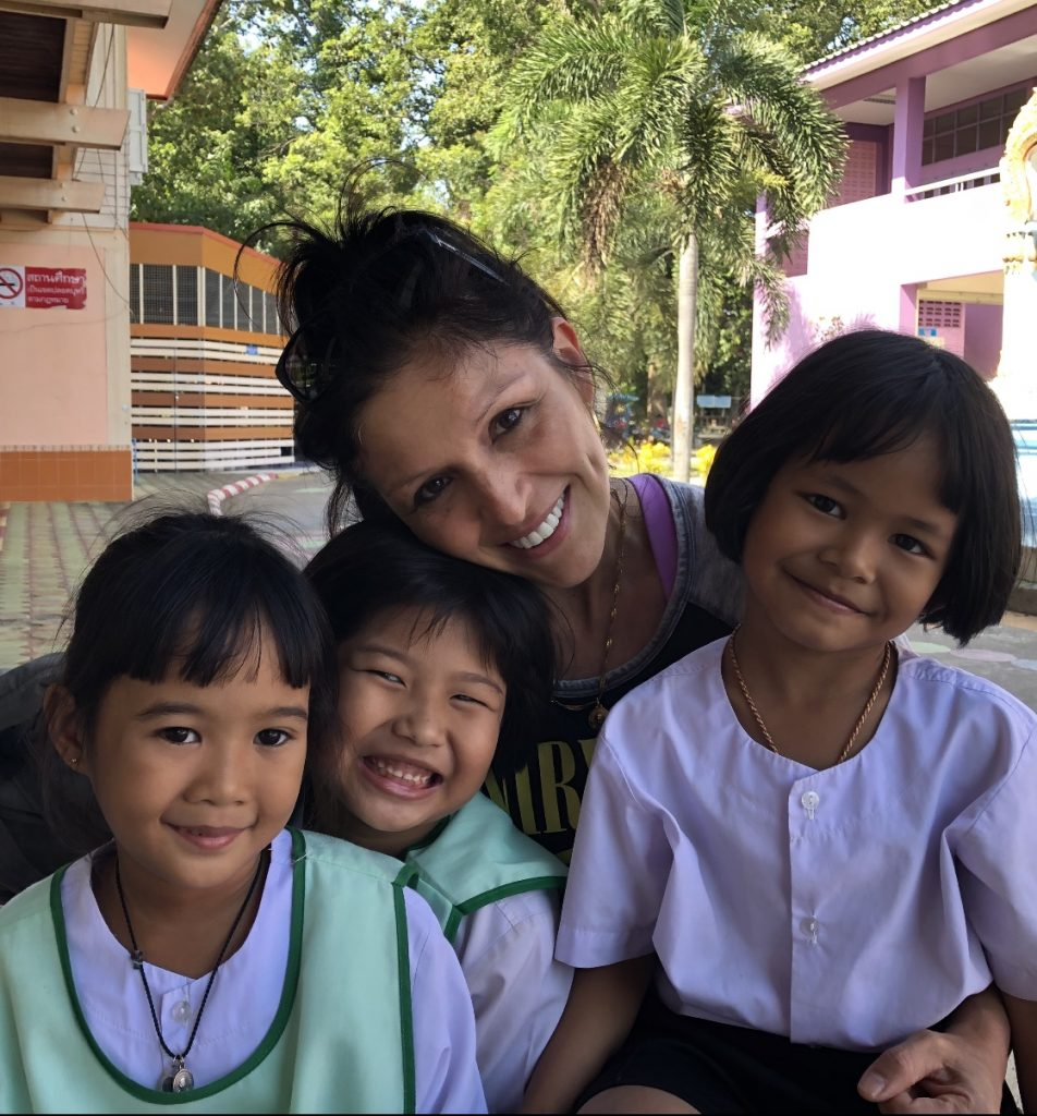 lucy with some thai children on placement in Singburi 952x1024 - English Teaching Thailand