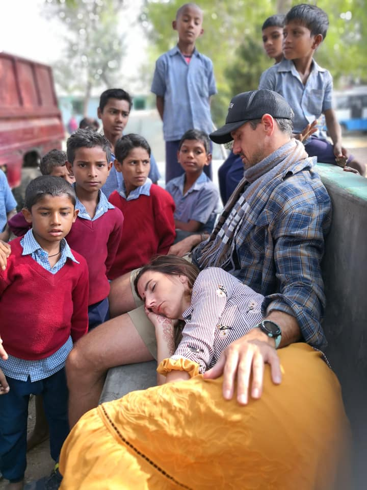 El having a nap with with the india children staring - Survivor couple Elena Rowland & Lee Carseldine in Bodhgaya, India