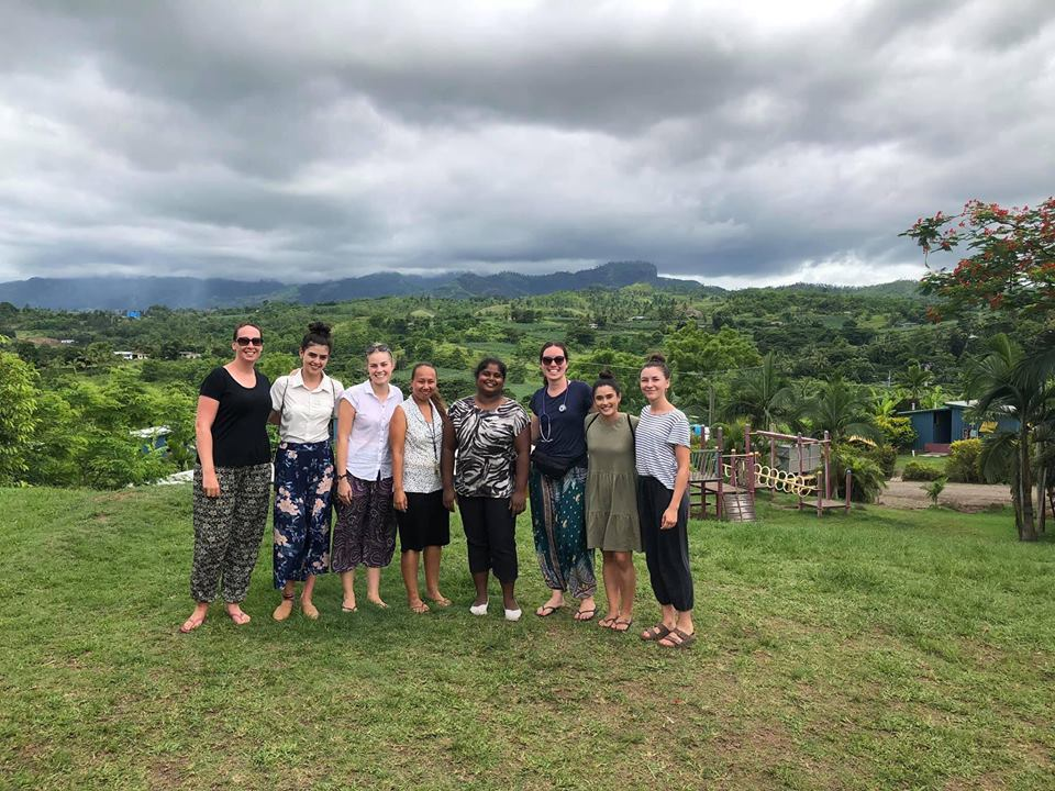 IVI volunteers in vanuatu with nice countryside in background - Copy