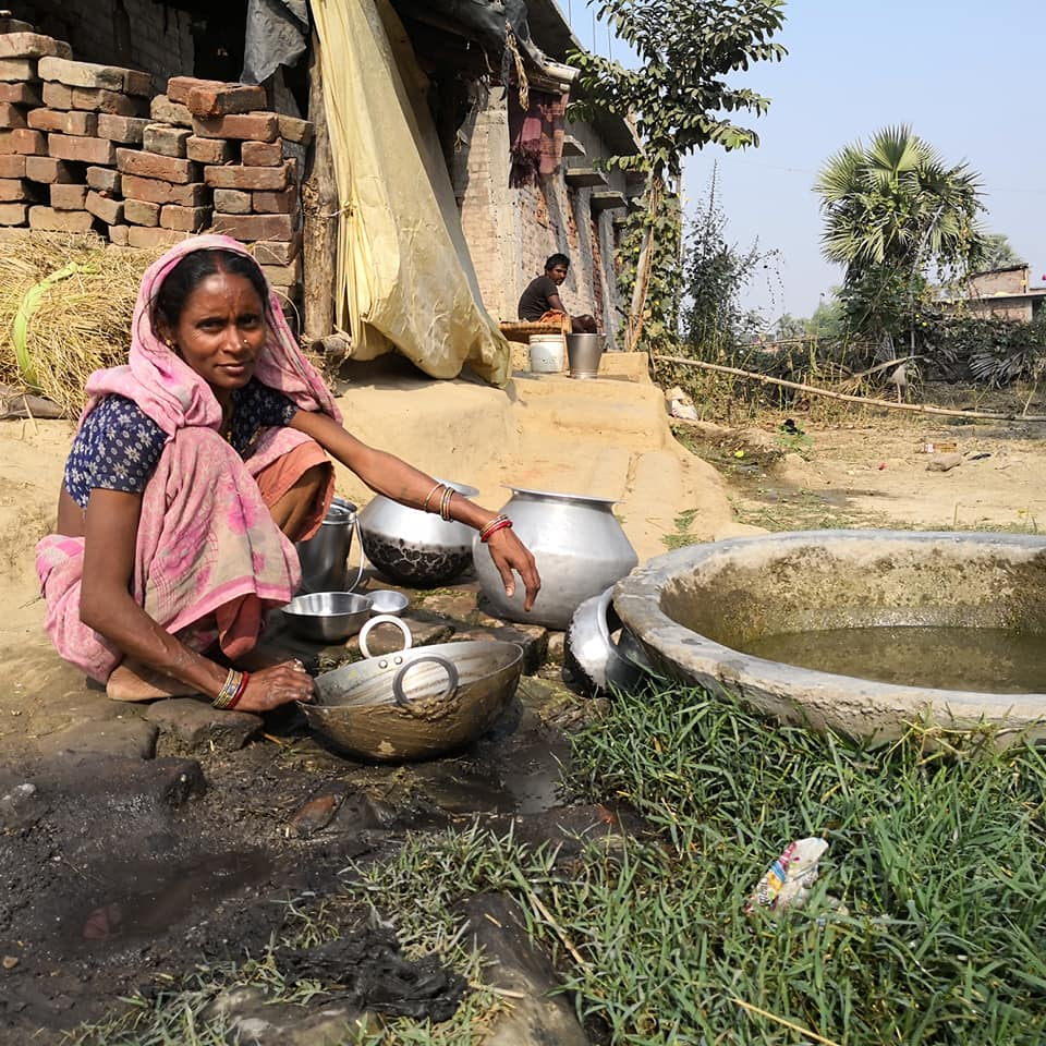 local woman washing on IVI project in India