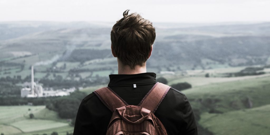 boy standing look out over mountain 1024x512 - Volunteering for Teens in Groups