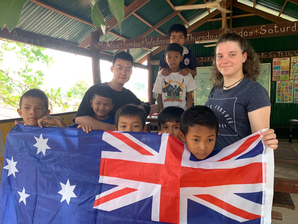 joydyn with kids in cambodia and australia flag 1024x768 - Cambodia Teaching