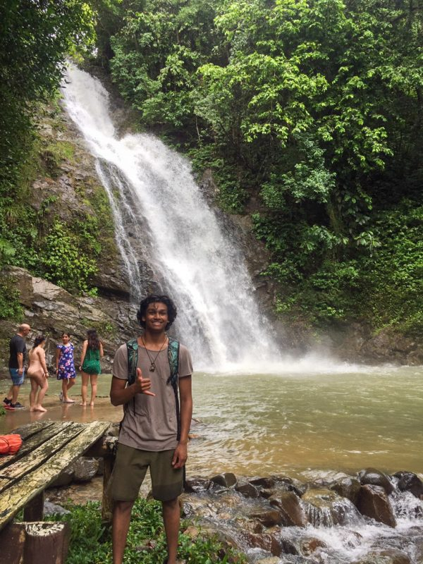 IVI volunteer by waterfall in Fiji