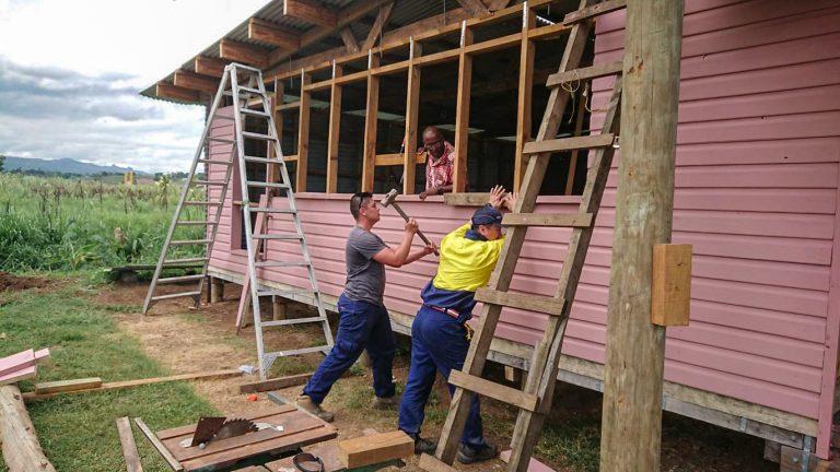 IVI voluntter working on fiji building project