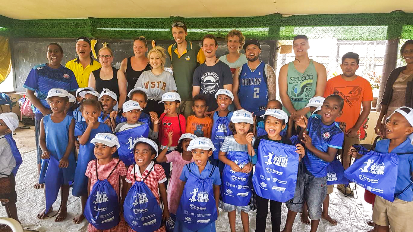 IVI Volunteers with group of children in Fiji