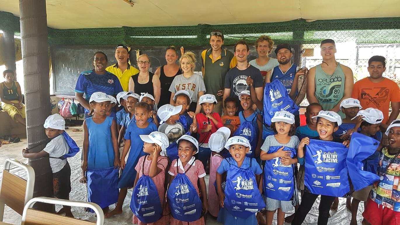 IVI volunteers with children in Fiji