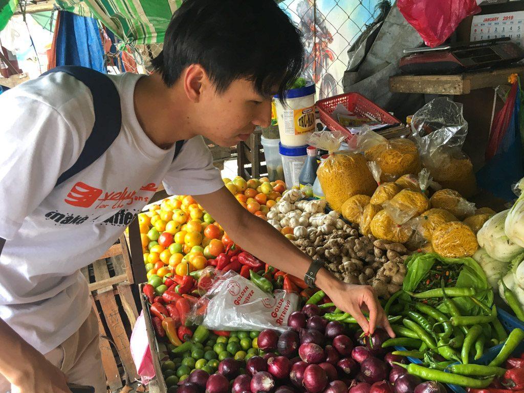 IVI volunteer at market stool in Philippines