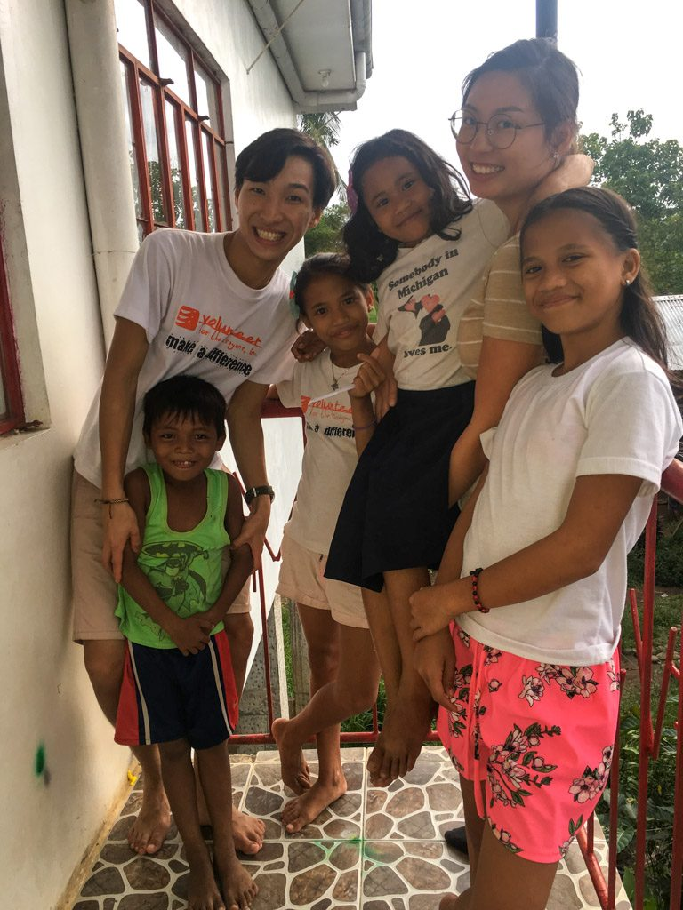 IVI volunteer with host family