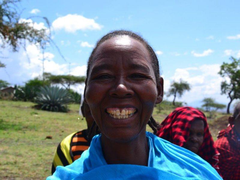 local Tanzanian woman smiling at camera