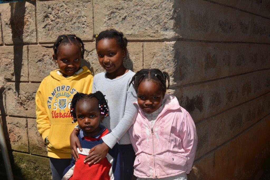 Group of local children kenya volunteering ivi