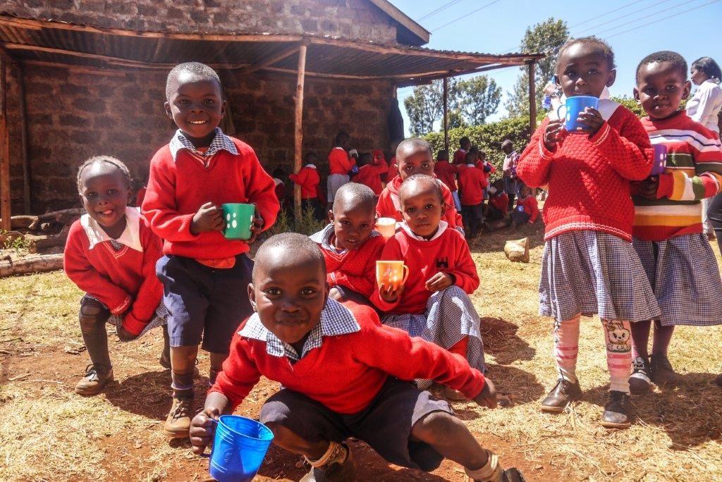 Students eating porridge 1024x684 - English Teaching in Kenya Experience