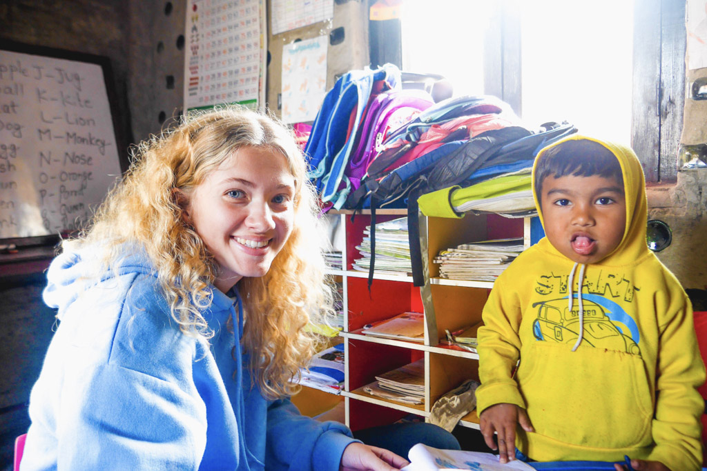 IVI volunteer with young child in Nepal