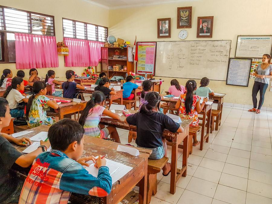 children at classroom desks working