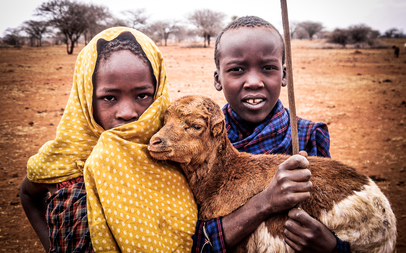 children with baby goat