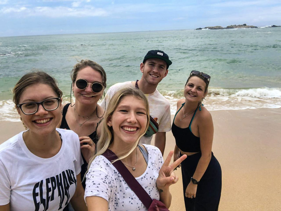 group of IVI volunteers on beach in Sri Lanka
