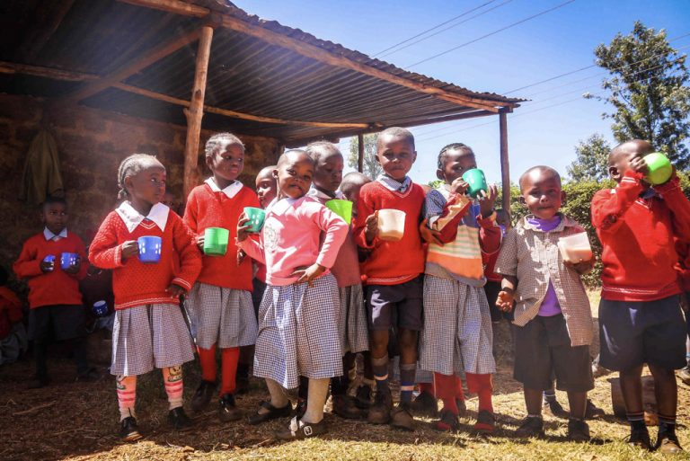 group of kindergaten kids with thier plastic drink cups-2