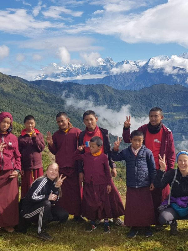 group of monks with mountain backdrop