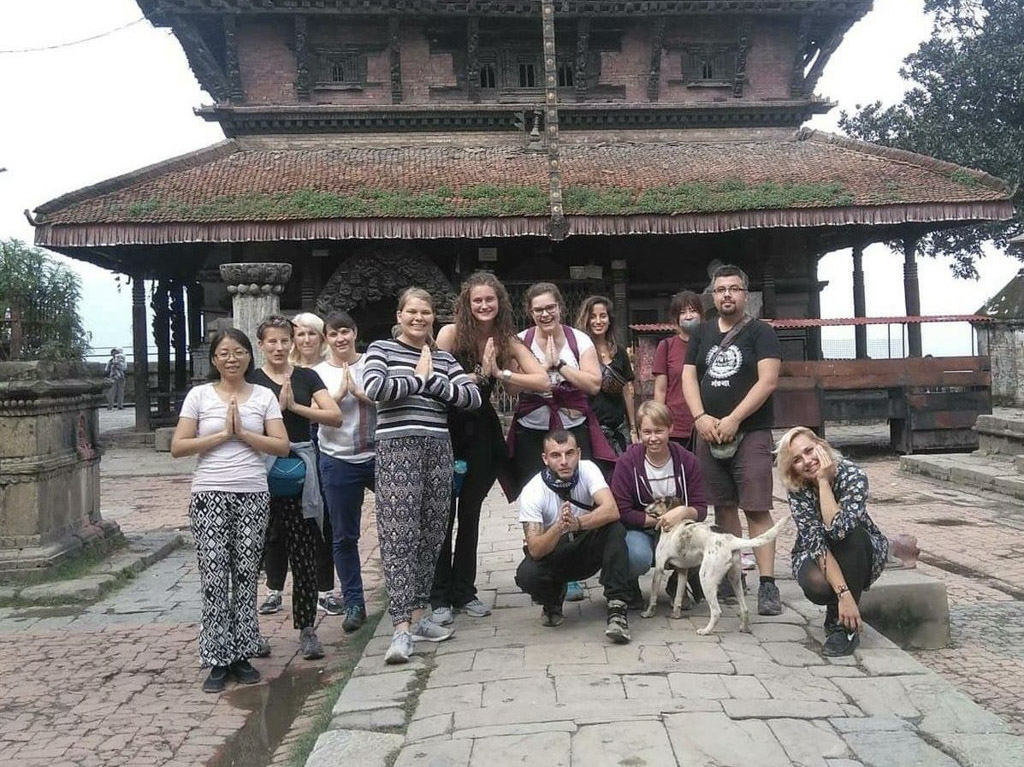 group pic by temple in Nepal