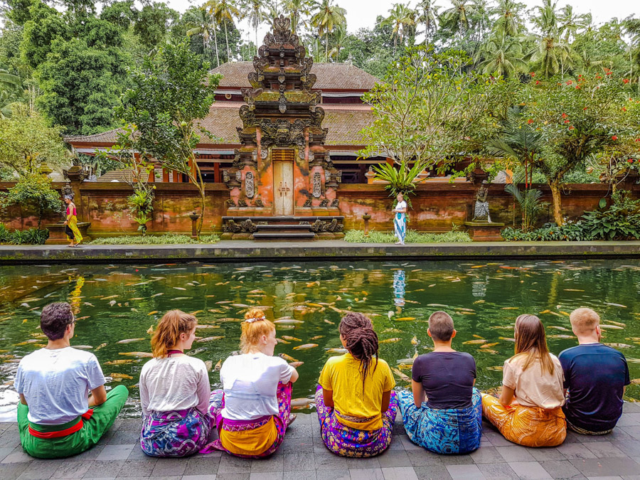 group sitting in front of temple