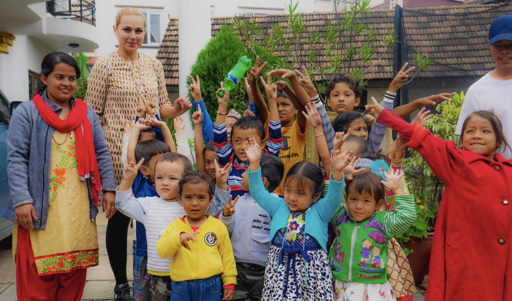 kindergarten children with hands in air