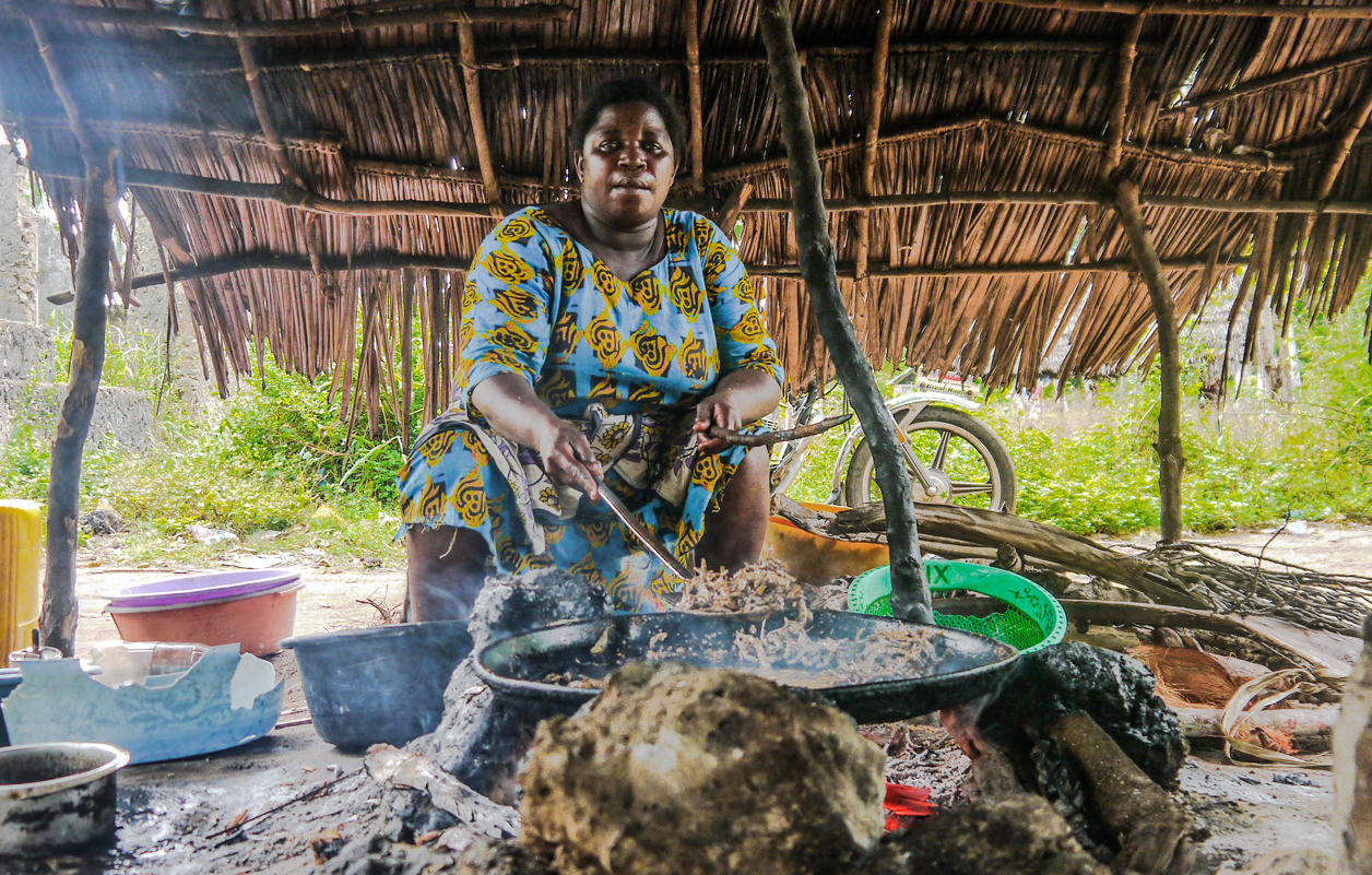 local Kenyan woman cooking on open fire