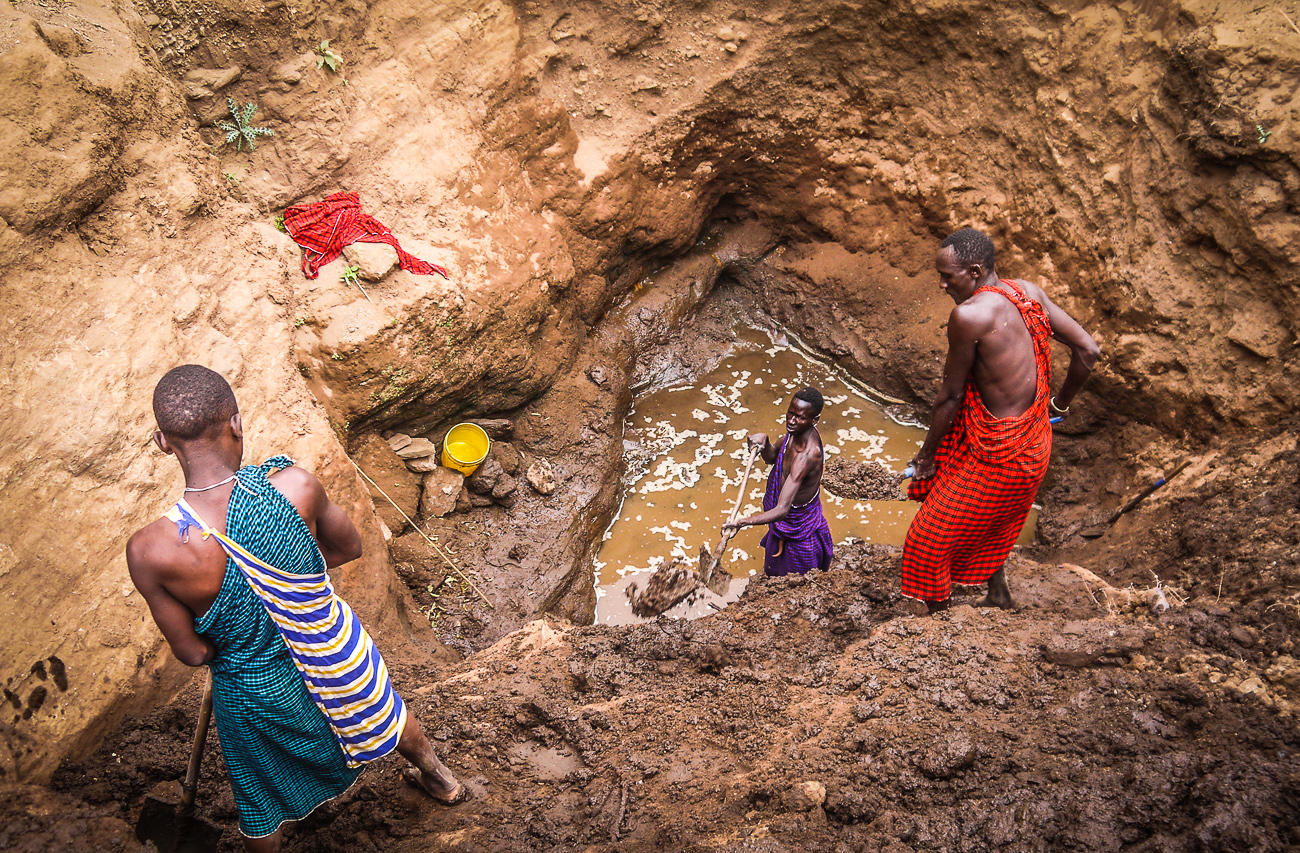men digging for water