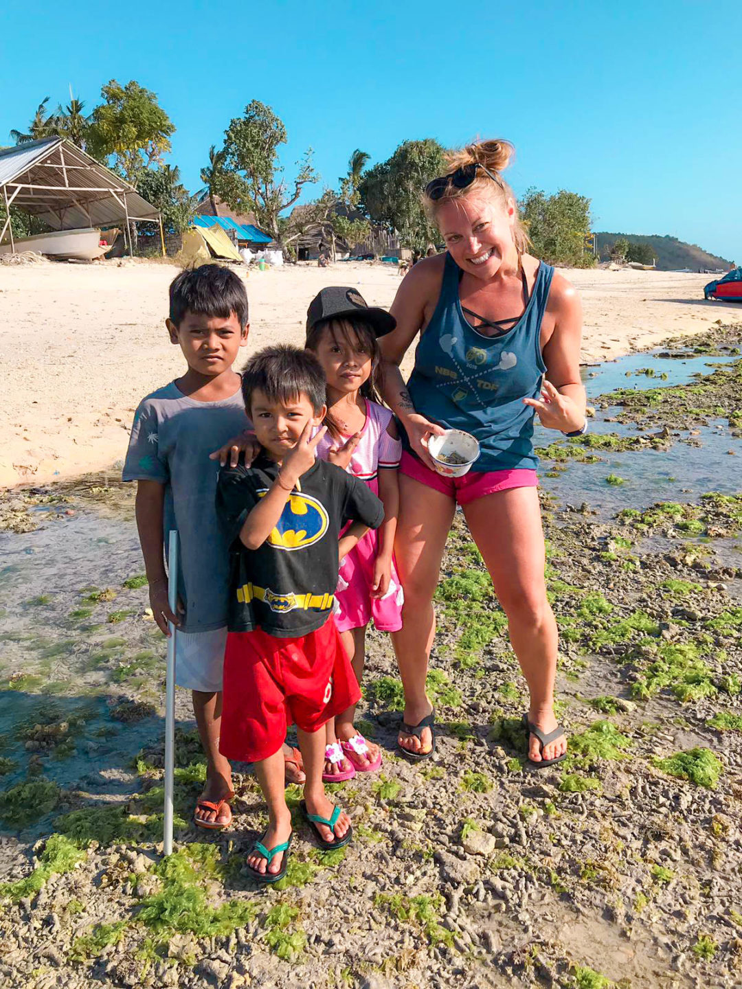 posing with local children at the beach