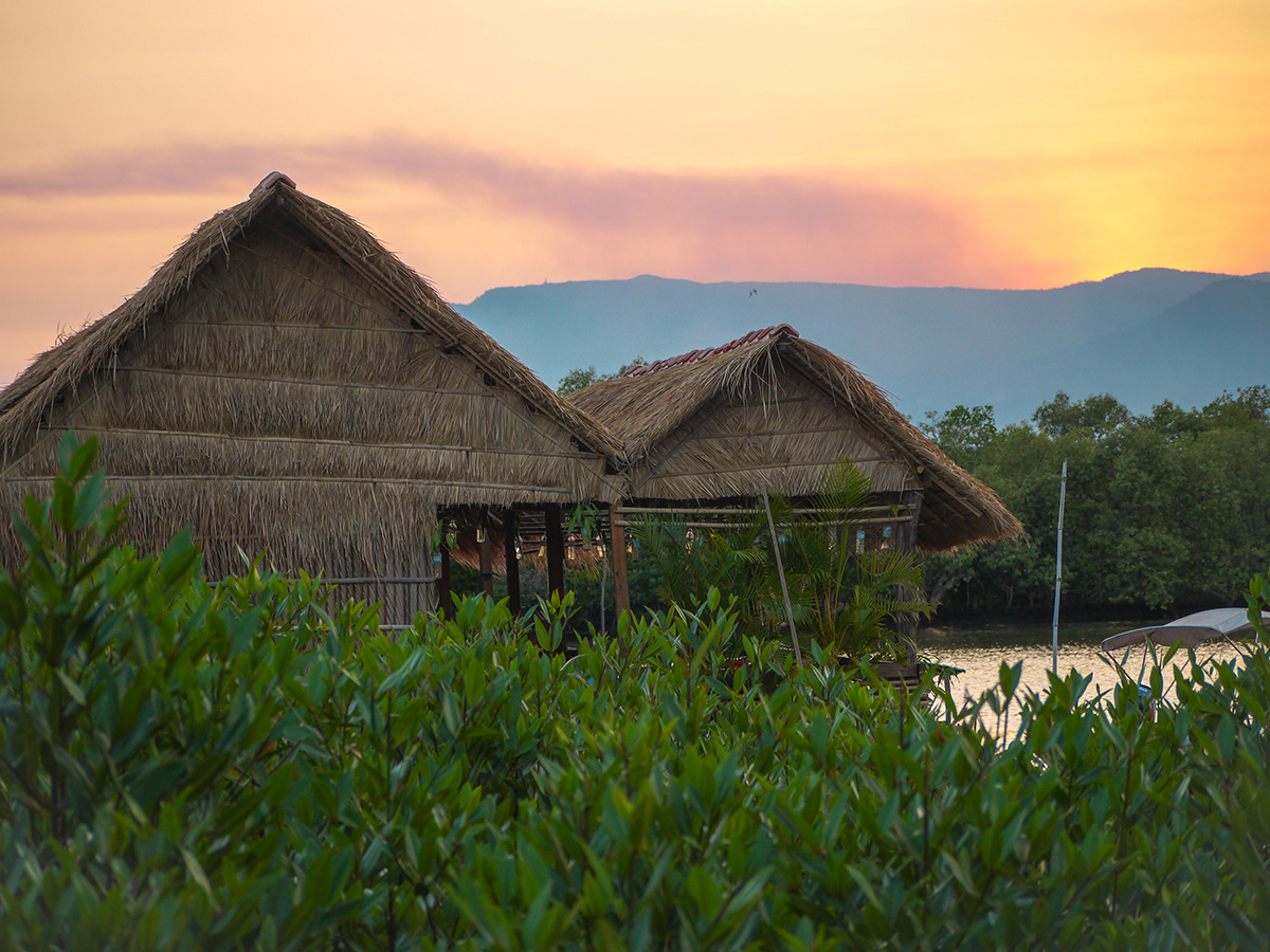 straw huts and beautiful sunset