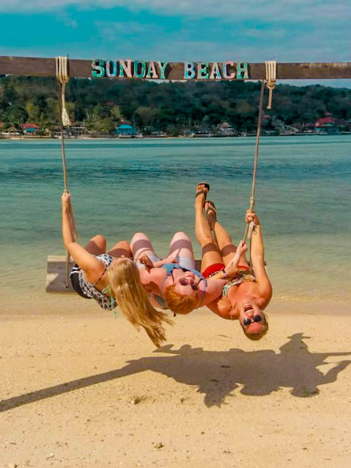 swinging on a beach swing