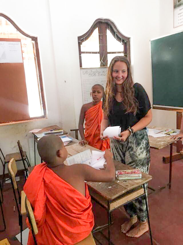 teaching monks in classroom