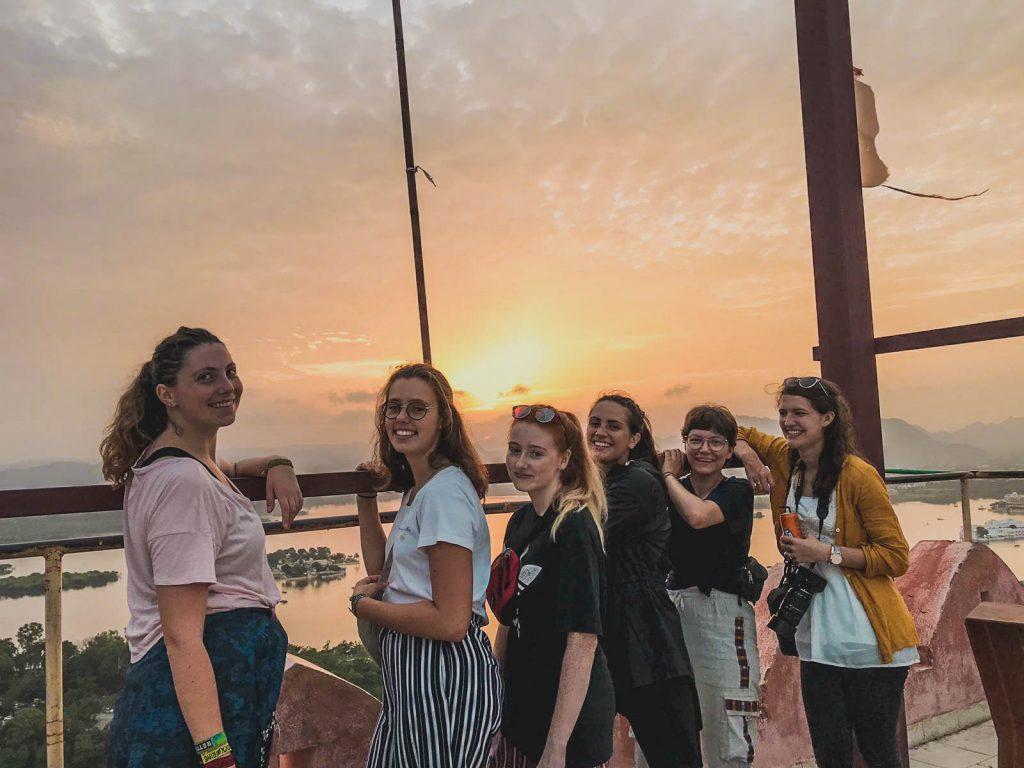 volunteers in front of sunset in India