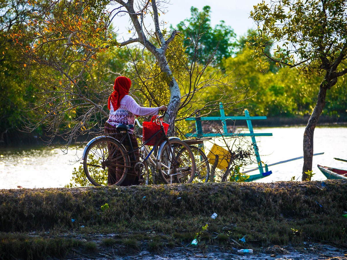 women walking bicycle in Cambodia