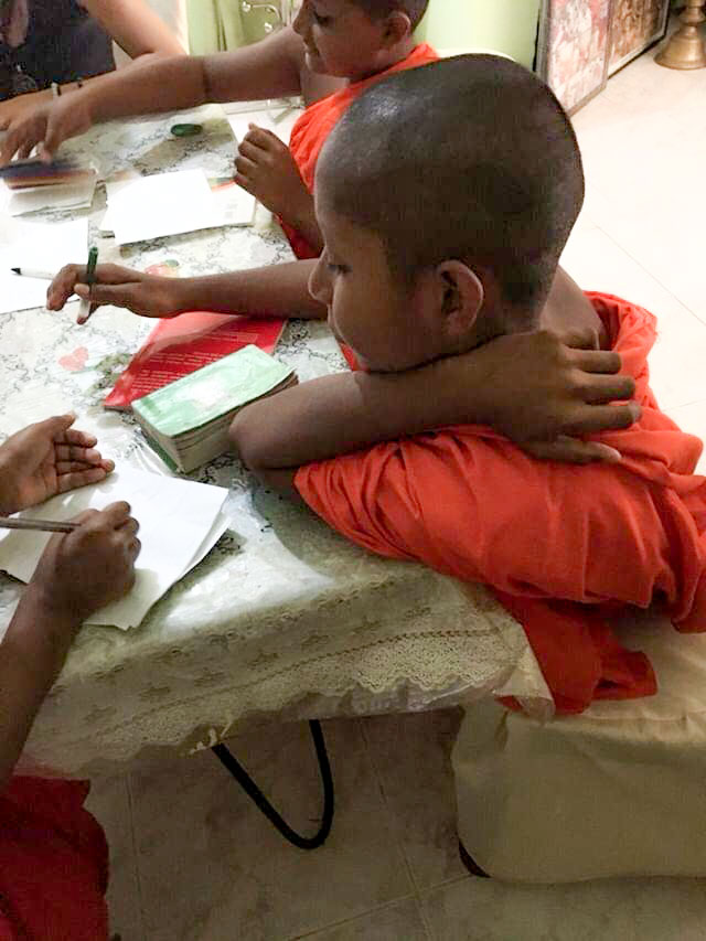 young monks learning to write