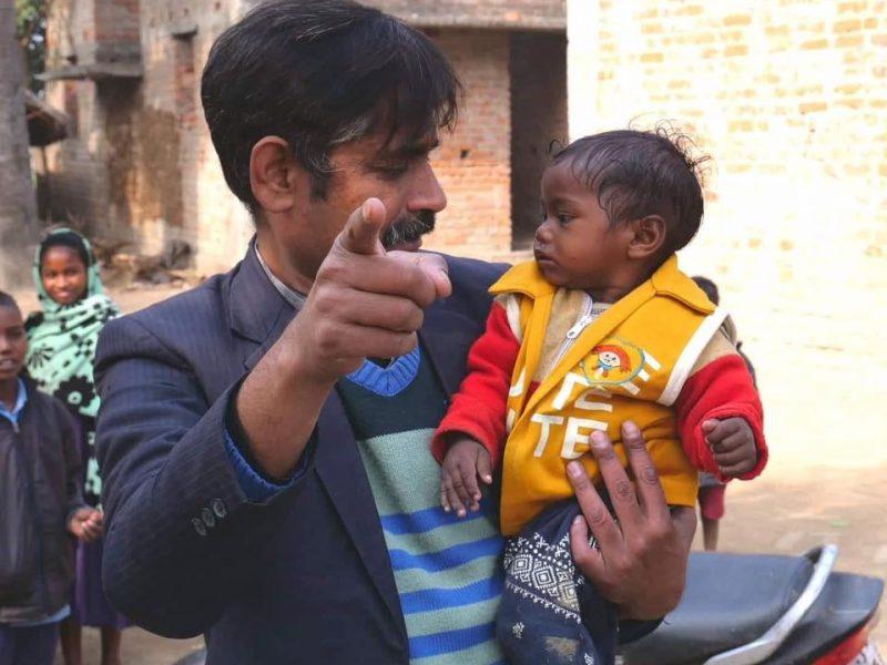 Bodhgaya director holding small child