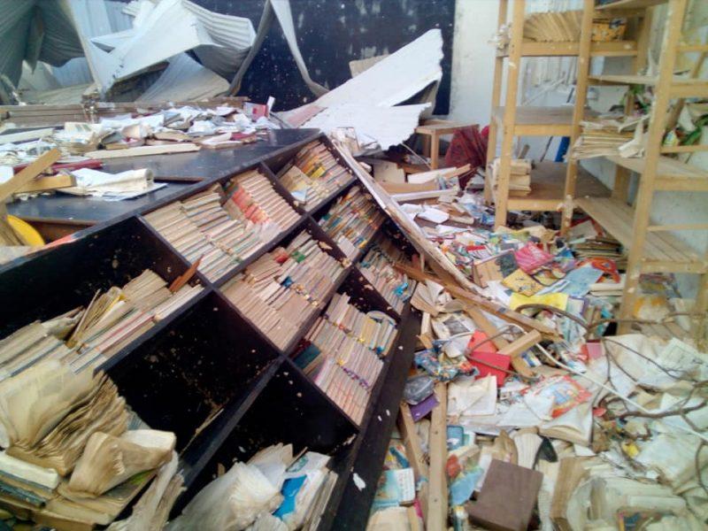 bookcase fallen in rubble